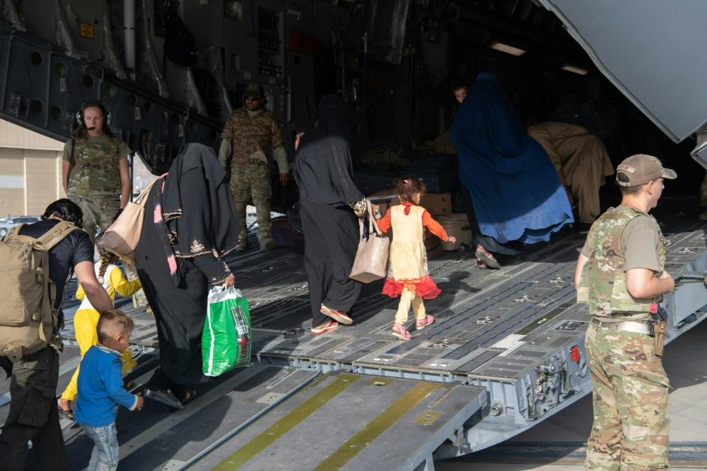 Refugees from Afghanistan board a US Air Force transport at Kabul airport