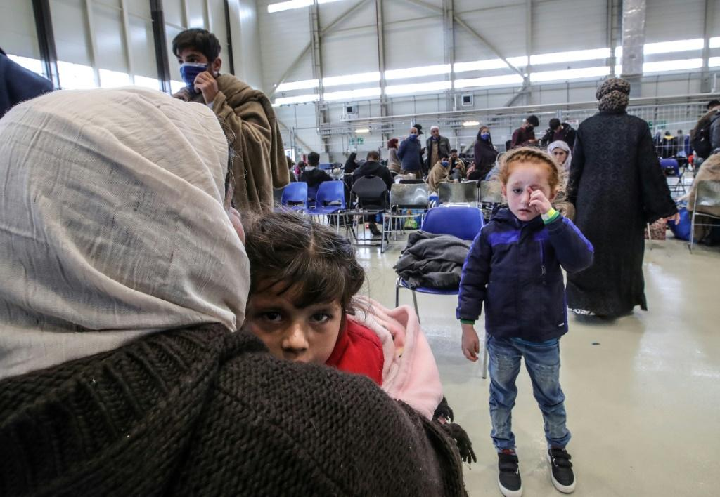 The Afghan evacuees have had to get past Taliban checkpoints before being flown to Qatar or Kuwait, and then on to Germany