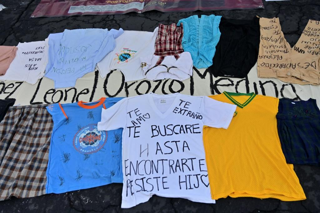 Families brought clothes of their missing loved ones to the demonstration