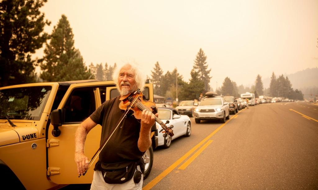 Mel Smothers rescued his violin when he was told he had to leave his home near Lake Tahoe