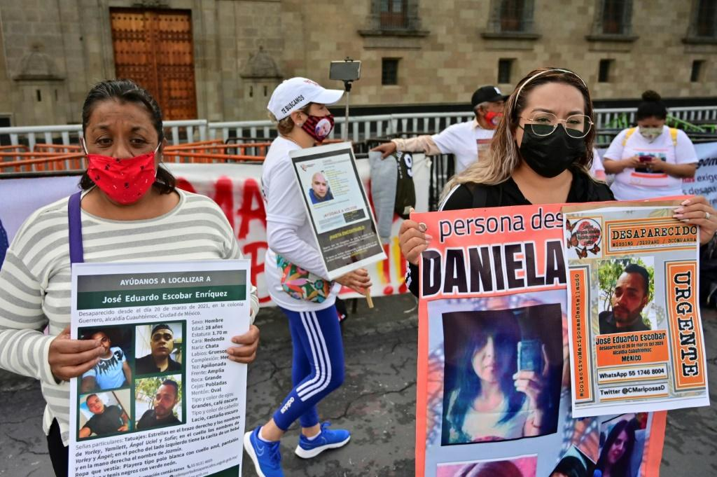 Relatives of missing Mexicans protest outside the presidential palace on International Day of the Victims of Enforced Disappearances