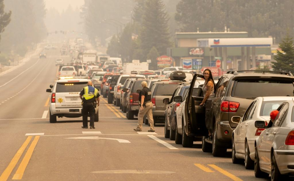 Roads out of South lake Tahoe are clogged as thousands of the city's residents heed orders to flee the approaching Caldor Fire