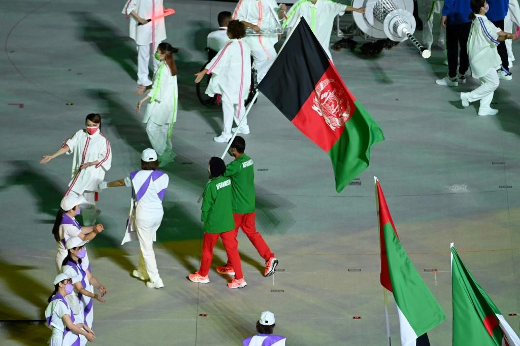 Afghanistan's Hossain Rasouli and Zakia Khudadadi carried their country's flag at the Paralympic closing ceremony
