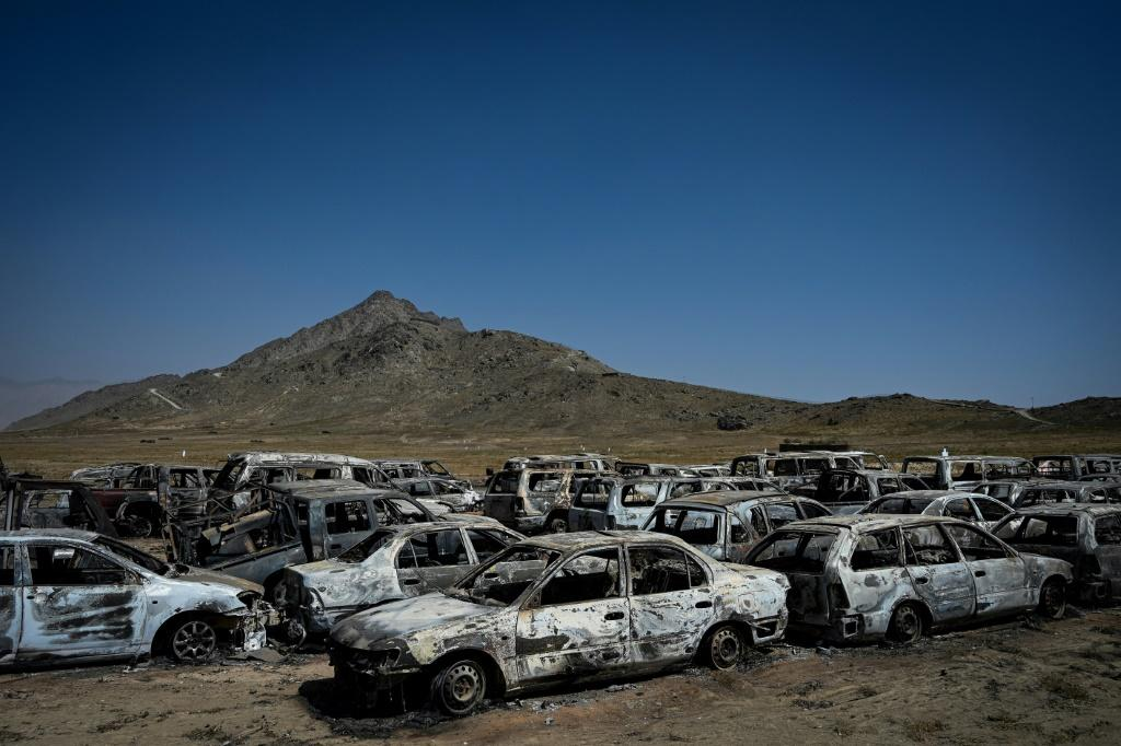 The parking lot is packed with the incinerated wrecks of scores of vehicles