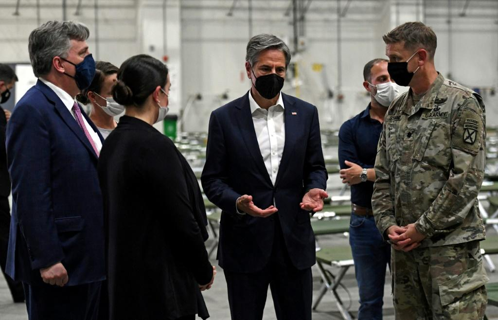 US Secretary of State Antony Blinken tours a processing centre for Afghan refugees at Al Udeid Air Base in the Qatari capital Doha