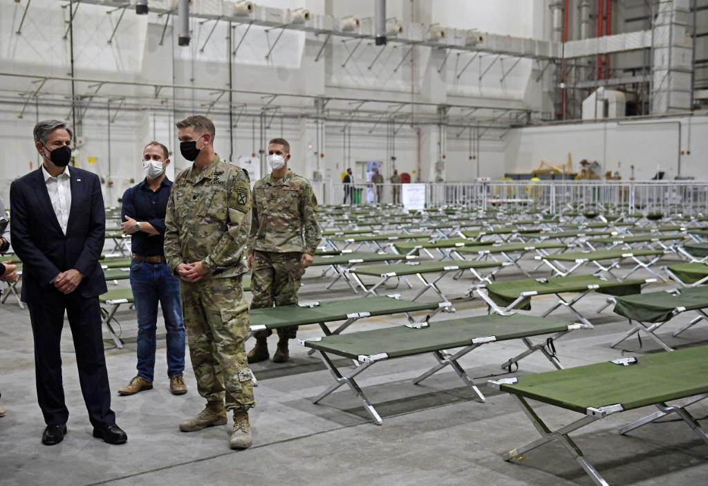 US Secretary of State Antony Blinken tours a processing centre for Afghan refugees at al-Udeid Air Base in the Qatari capital Doha