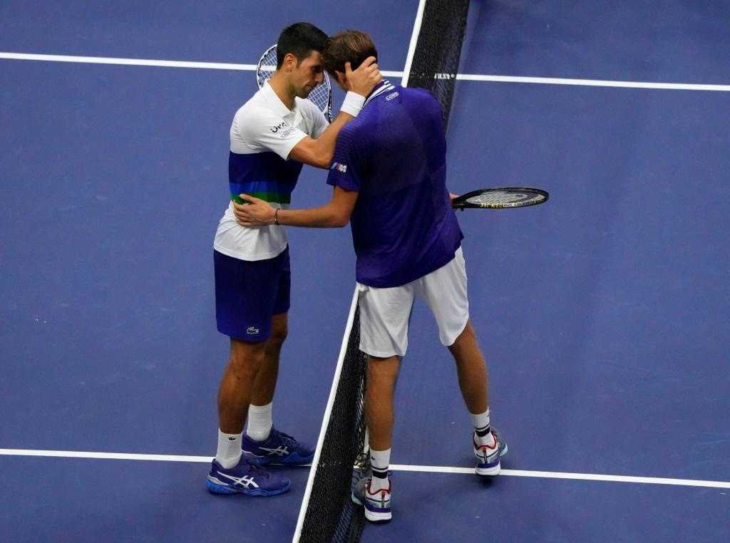 Respect: Russia's Daniil Medvedev and Serb Novak Djokovic embrace at the net after Medvedev's victory in the 2021 US Open final