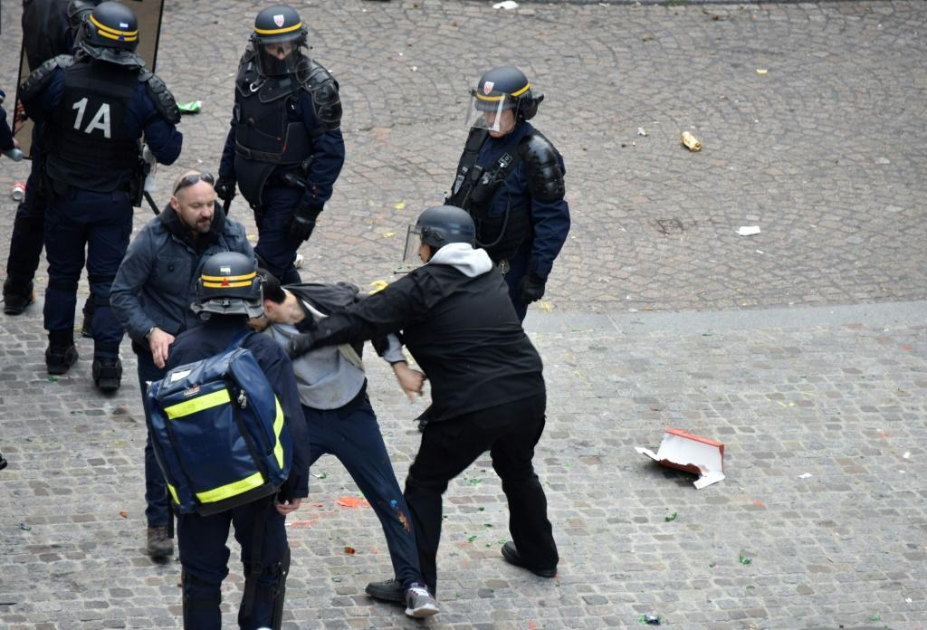 Alexandre Benalla, centre, during the protest in Paris on May 1, 2018.
