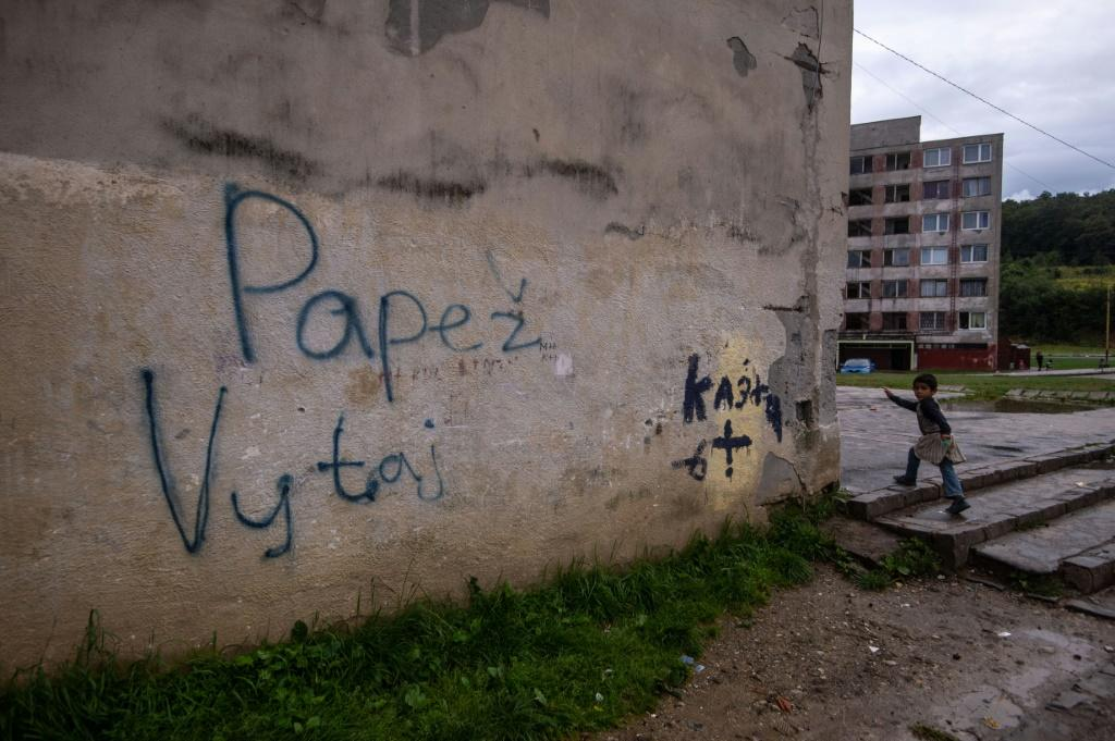 Graffitti on a wall in the Lunik IX estate reads 'Welcome Pope'