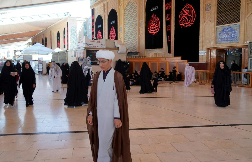 Sheikh Qorban Ali, seen here walking in the Imam Ali shrine in Iraq's central holy shrine city of Najaf, dreams of going home to Afghanistan