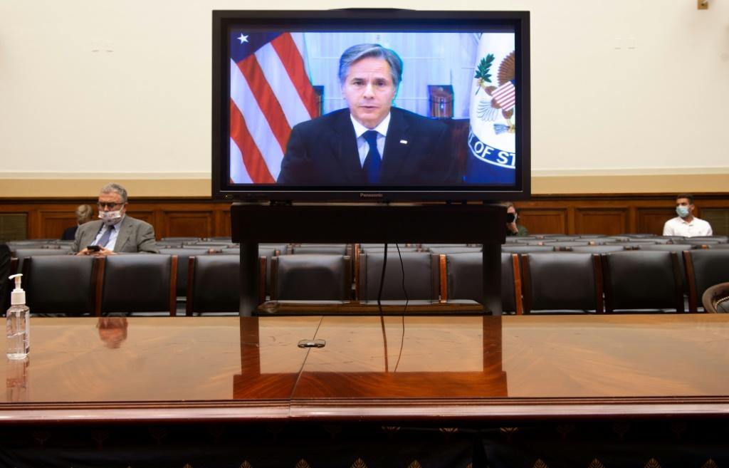 US Secretary of State Antony Blinken appears on a television screen as he testifies virtually on the US withdrawal from Afghanistan during a House Foreign Affairs Committee hearing