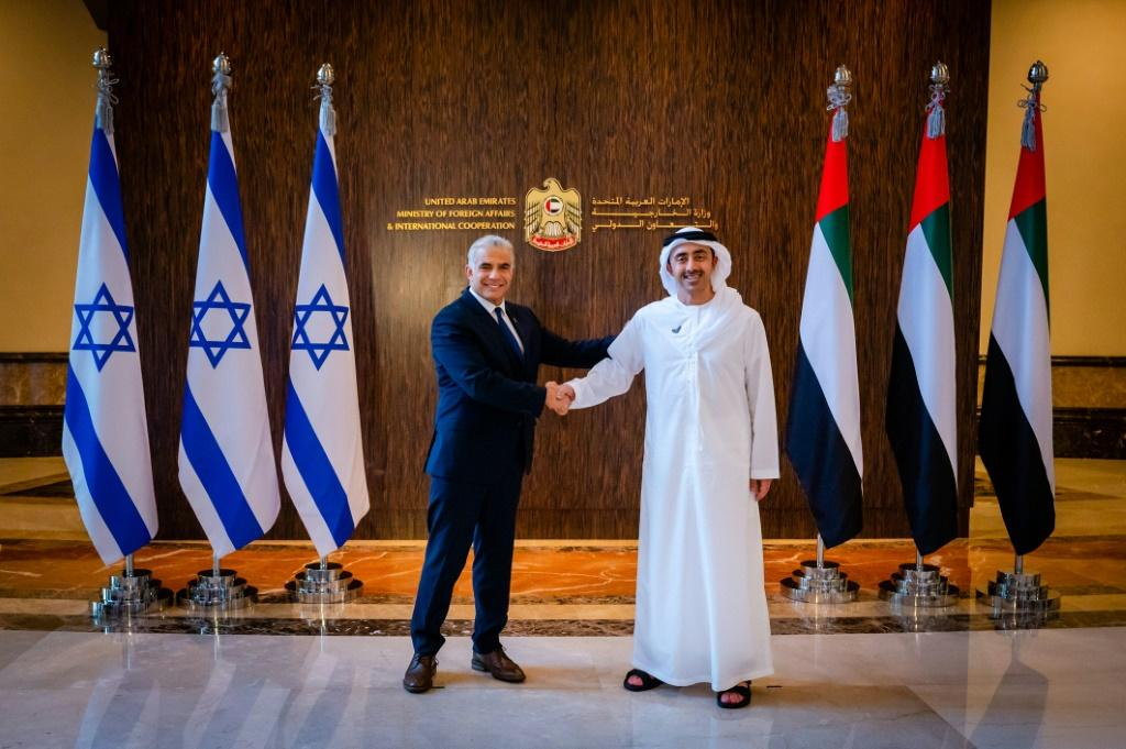 Israel's foreign minister Yair Lapid (L) visited Abu Dhabi in June to open the Jewish state's first embassy in the Gulf