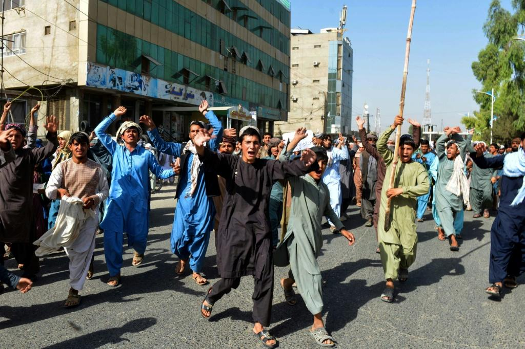 Local residents take part in a protest in Kandahar