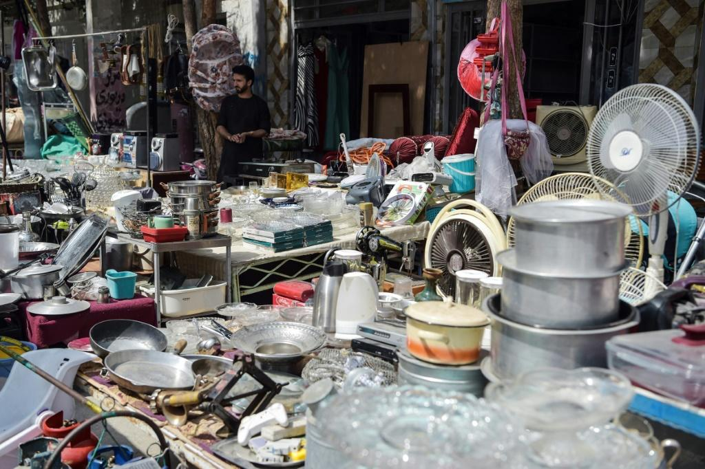 Ordinary Afghans are selling household items to pay for essentials like food