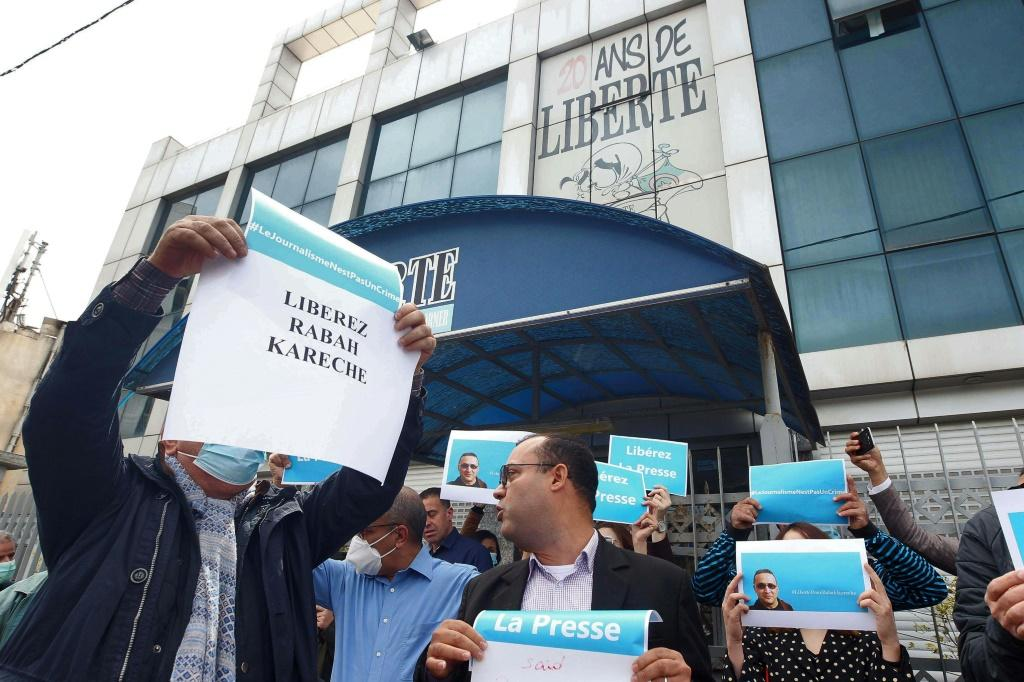 Protesters outside the headquarters of French-language newspaper 'Liberte' in April