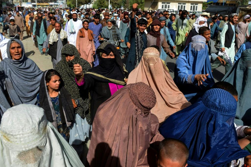 Residents of the Afghan city of Kandahar take part in a protest march against a reported demand by the Taliban for them to leave their homes on state-owned land