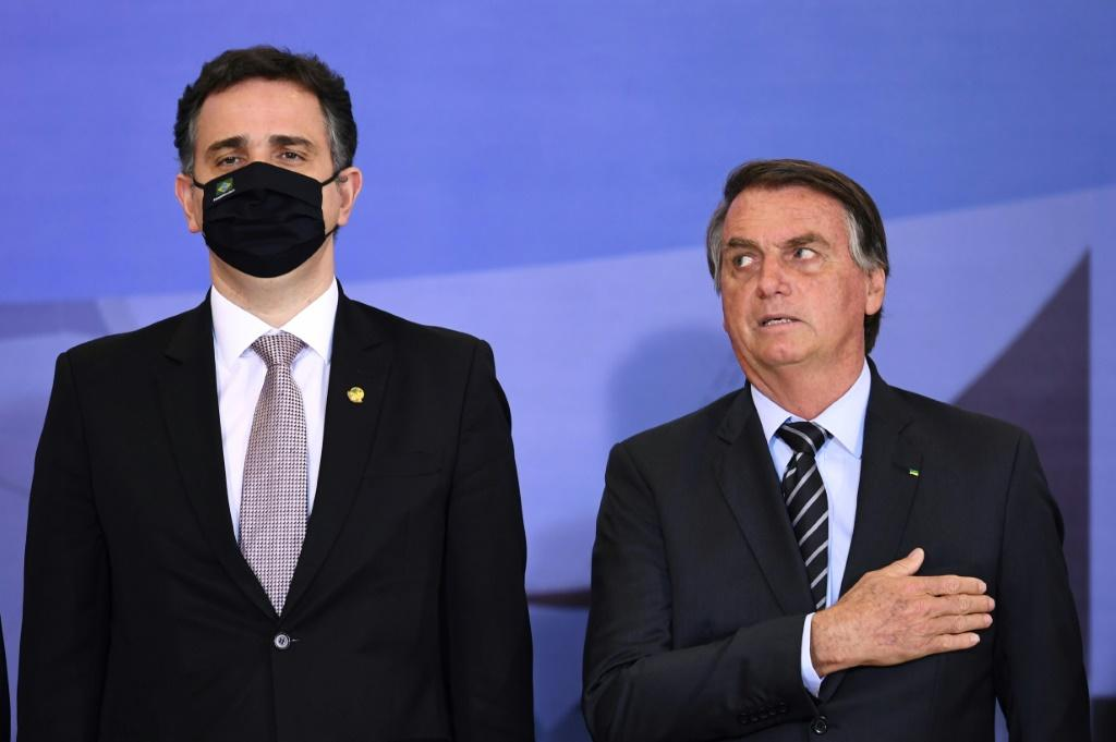 """Brazilian President Jair Bolsonaro (R) has launched fiery attacks on the Supreme Court and the country's election system, prompting Human Rights Watch to warn that he is """"threatening democratic rule"""