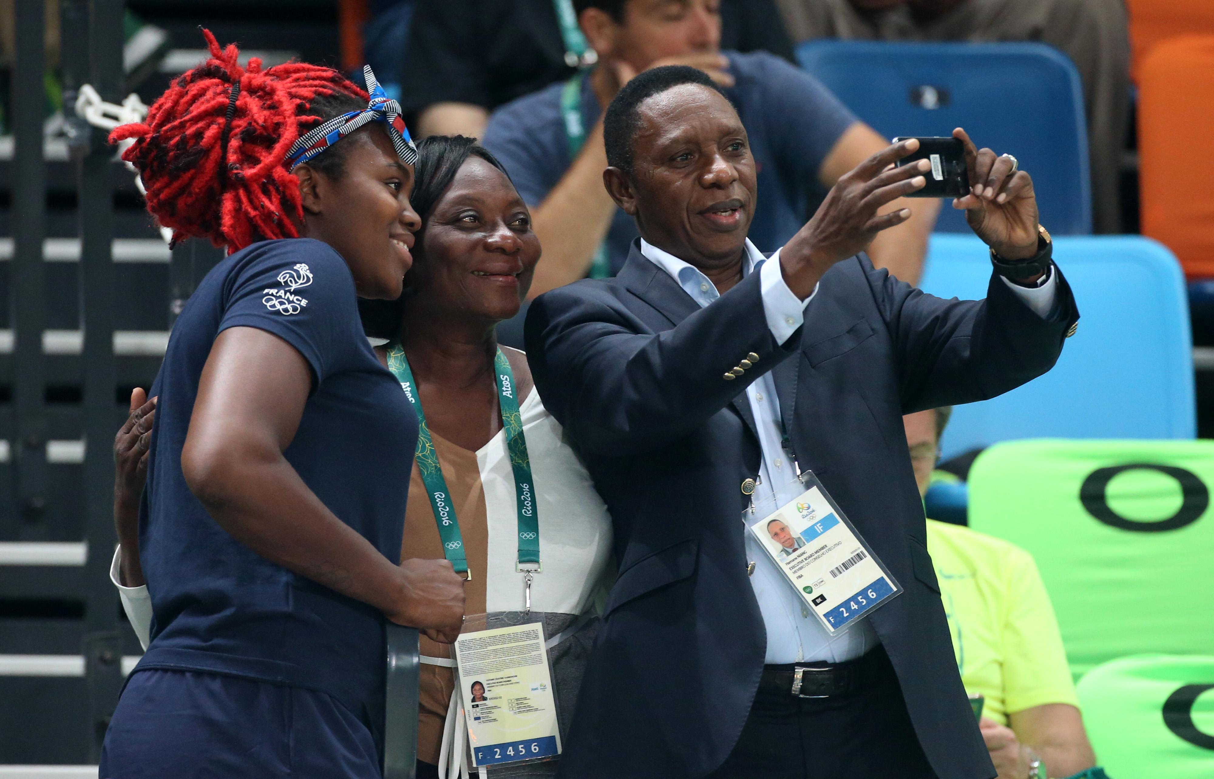 Hamane Niang takes a picture with Isabelle Yacoubou of France on day 13 of the Rio 2016 Olympic Games at Arena Carioca 2