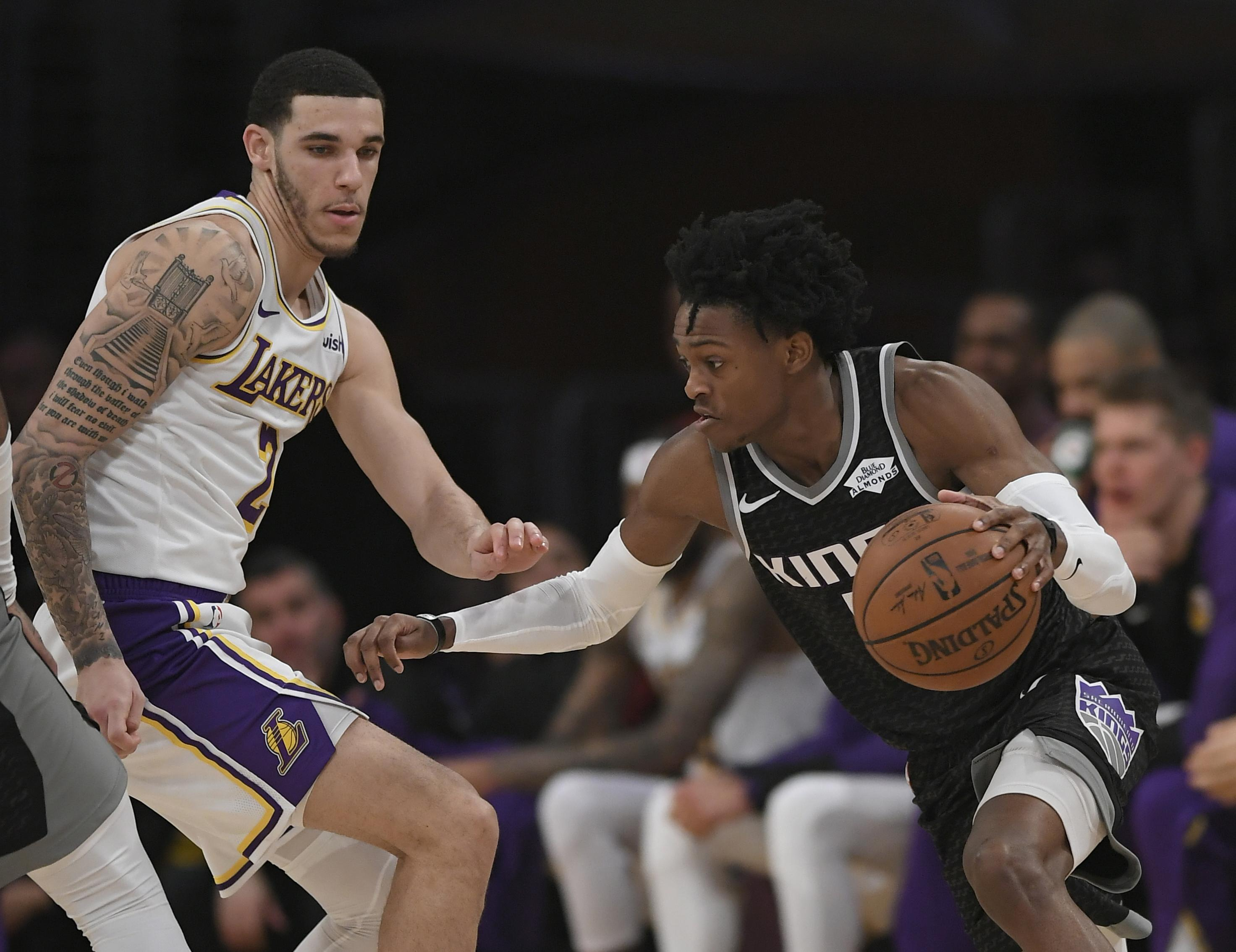Lonzo Ball #2 of the Los Angeles Lakers guards De'Aaron Fox #5 of the Sacramento Kings