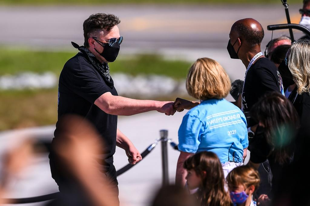 SpaceX CEO Elon Musk (L) meets with family members during the Inspiration4 crew send off at NASA's Kennedy Space Center in Florida