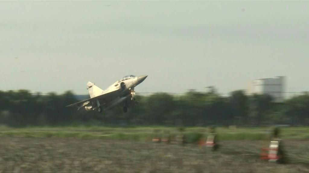 Taiwanese airforce fighter jets and an E-2K Early Warning Aircraft land and take off on a motorway in an exercise simulating a mock attack by enemies destroying their airbase. The military exercise is part of Taiwan's annual live-fire war games to prepare