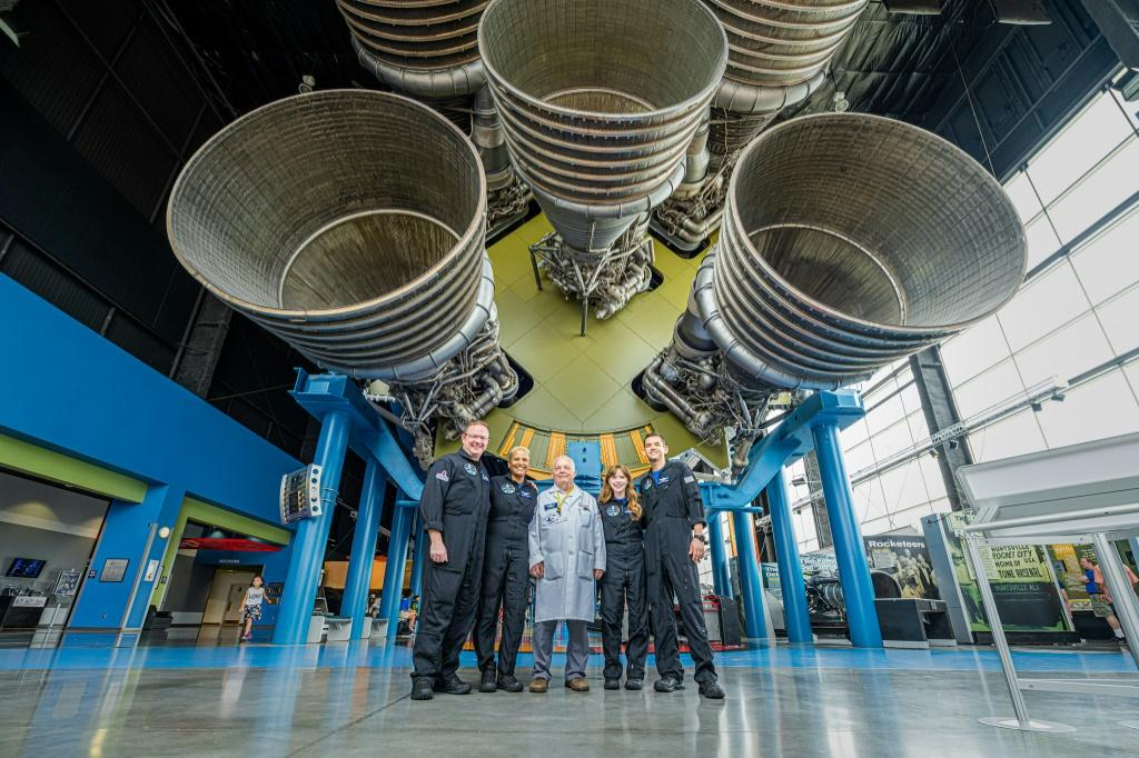 The Inspiration4 crew (L-R) Chris Sembroski, Sian Proctor, Hayley Arceneaux and Jared Isaacman, posing with a technician (C) in Huntsville, Alabama