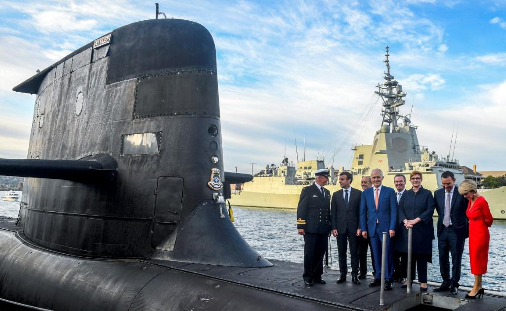 French President Emmanuel Macron and Australian Prime Minister Malcolm Turnbull stand on the deck of HMAS Waller, a Collins-class submarine operated by the Royal Australian Navy, in Sydney in May 2018 as France fulfilled a submarine deal