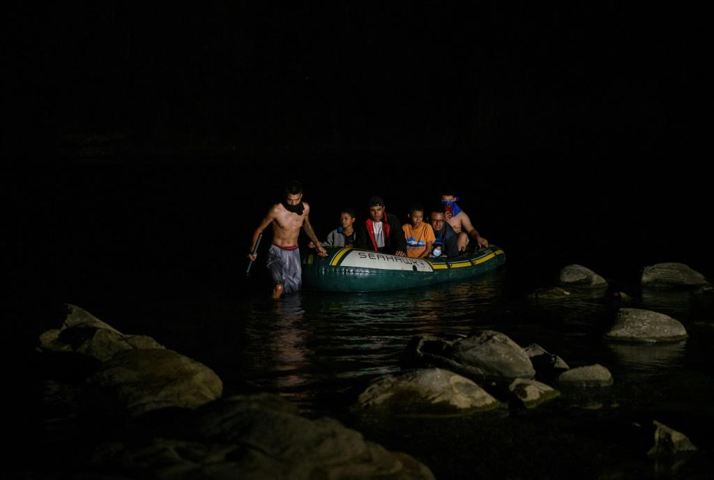 Migrants arrive in the United States near Roma, Texas after crossing the Rio Grande from Mexico.