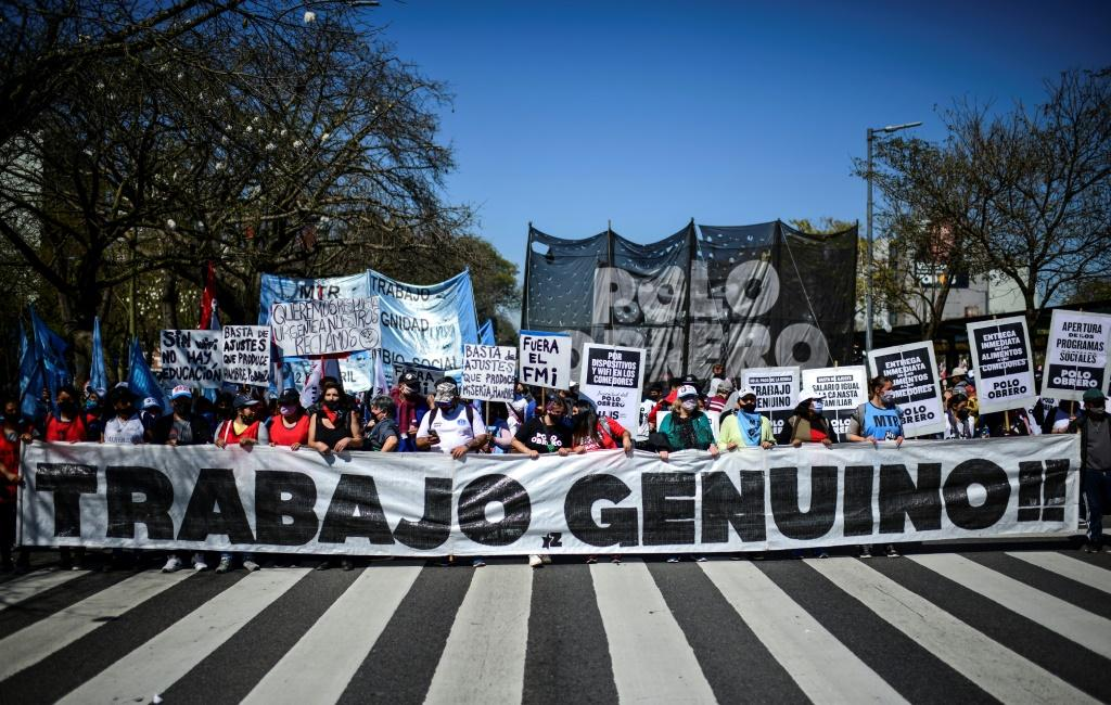 """Protesters rally against Argentine President Alberto Fernandez behind a banner reading """"Genuine Work!"""" at 9 de Julio avenue, in Buenos Aires, on September 16, 2021"""