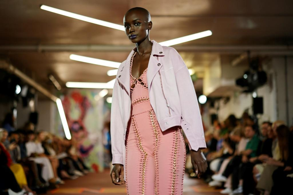 A model presents a creation from British designer Mark Fast's Spring/Summer 2022 collection on the first day of London Fashion Week in London on Friday
