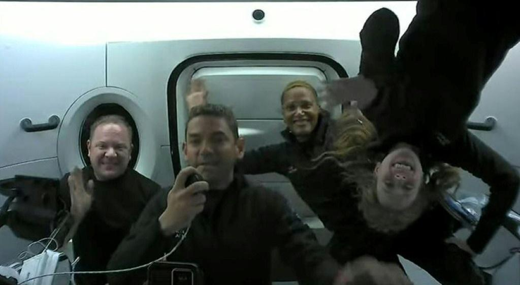 A screengrab from the SpaceX live webcast shows Inspiration4 crew (from L) Chris Sembroski, Jared Isaacman, Sian Proctor and Hayley Arceneaux