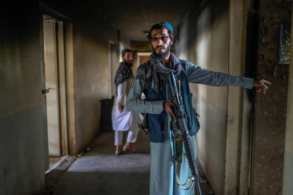 Taliban gunmen who now control Pul-e-Charkhi say the 11 blocks in the main wing each used to house 1,500 inmates