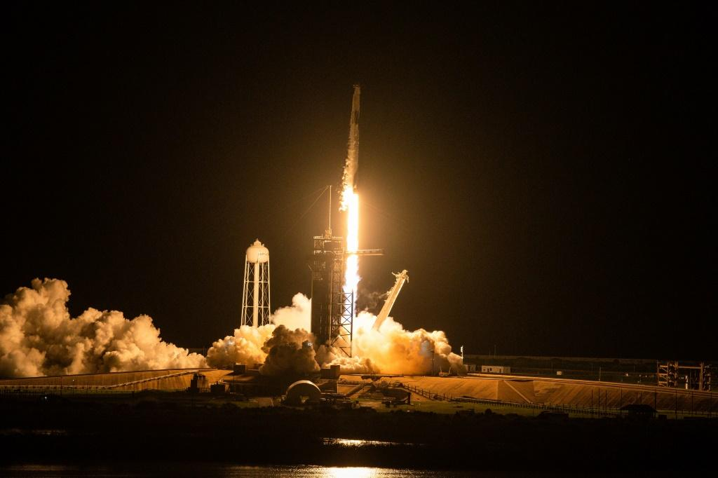 The SpaceX Falcon 9 rocket carrying the Inspiration4 crew launches from Pad 39A at NASA's Kennedy Space Center in Cape Canaveral, Florida