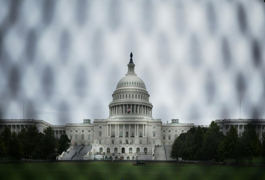 The US Capitol is seen through a temporary security fence in Washington, DC on September 16, 2021. Security measures are heightened in Washington, DC, in preparation for a September 18 demonstration to protest against the prosecution of suspects in the Ja