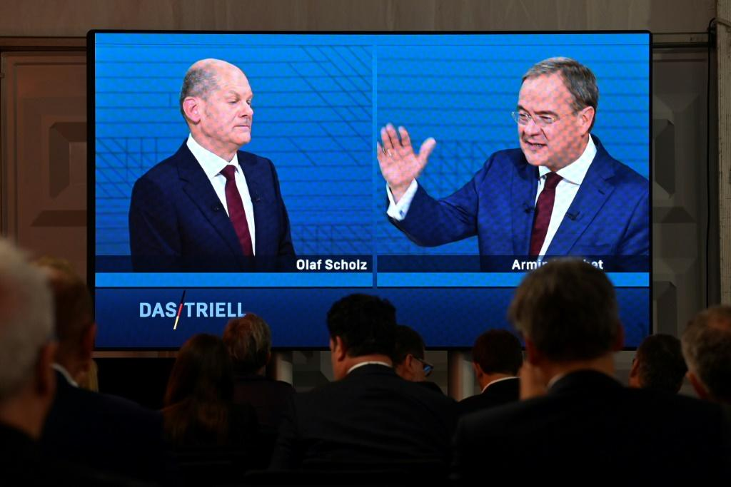 Laschet (R) has tried out two primary lines of attack against Scholz (L)