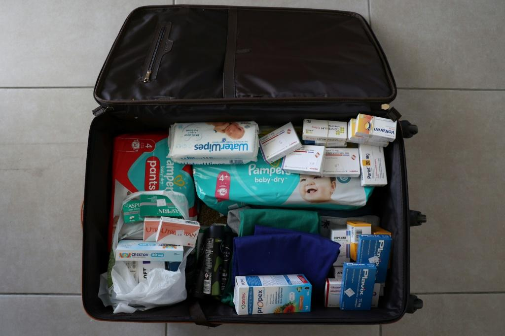 Lebanese expats pack their luggage with supplies including medicine each time they travel to their home country, which is running out of everything