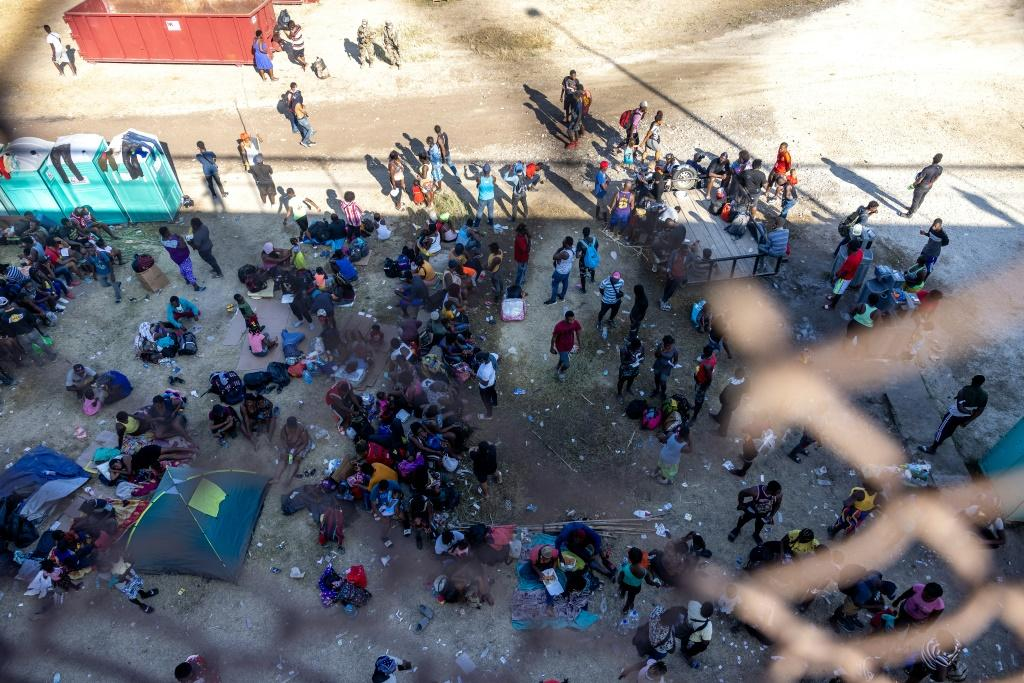 Migrants, mostly from Haiti, gather at a makeshift encampment under the International Bridge in Del Rio, Texas on the border with Mexico
