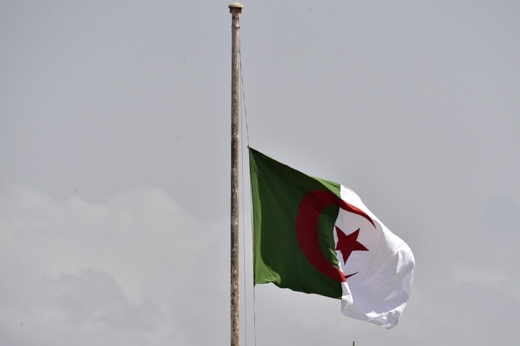 The Algerian national flag flies at half mast in the capital Algiers on September 18, 2021, before the funeral of former president Abdelaziz Bouteflika