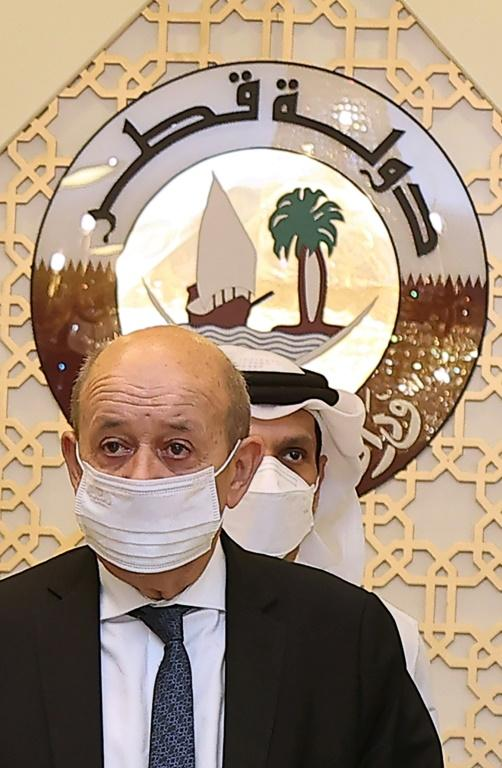 French Foreign Minister Jean-Yves Le Drian, seen on a September 2021 visit to Qatar, has no meeting scheduled with US Secretary of State Antony Blinken amid anger over a submarine deal