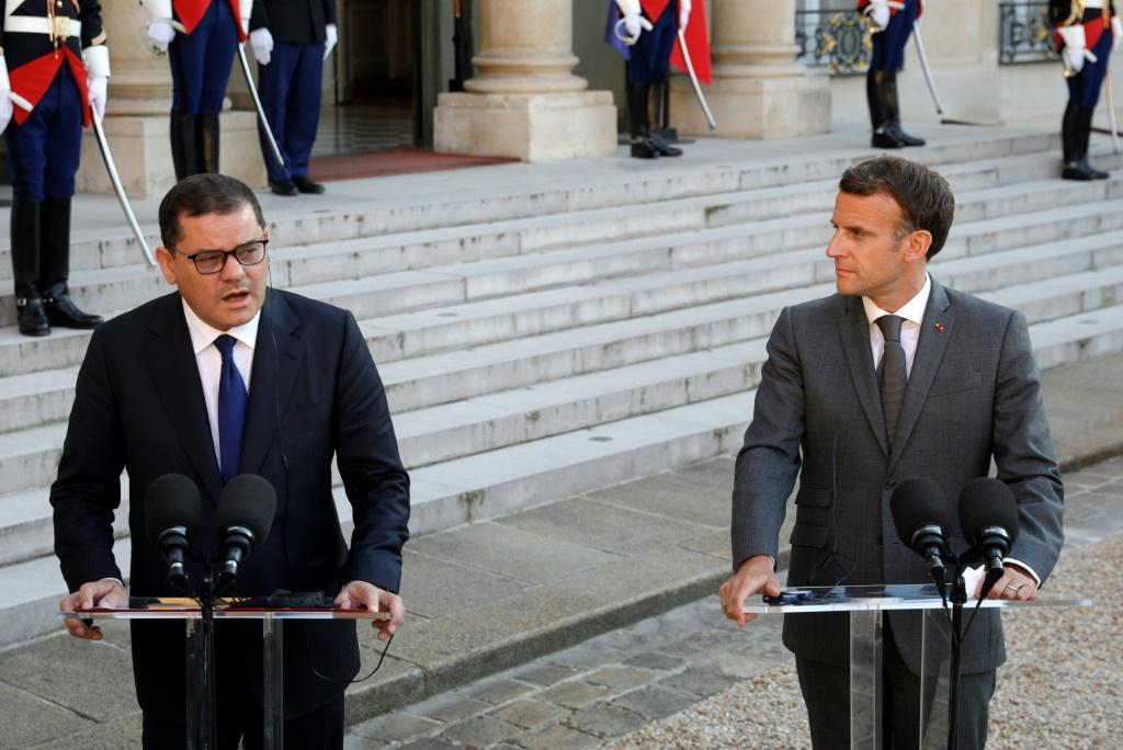 Libya's Interim Prime Minister Abdul Hamid Dbeibah (L) and French President Emmanuel Macron give a speech at the Elysee Palace in Paris, on June 1, 2021