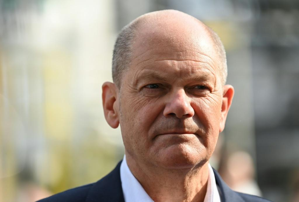 Olaf Scholz has been accused by Angela Merkel's conservatives of brushing the controversy under the carpet
