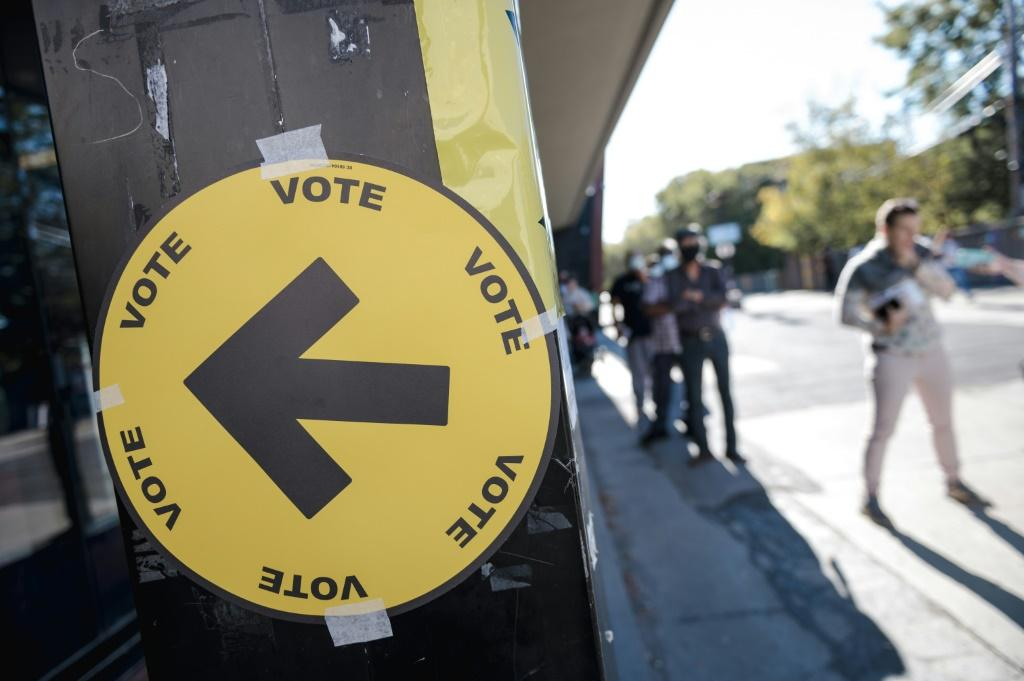 People line up at a Montreal polling station to vote in hotly-contested Canadian snap elections
