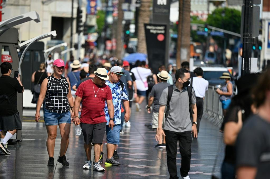 Tourists walk on Hollywood Boulevard's Walk of Fame