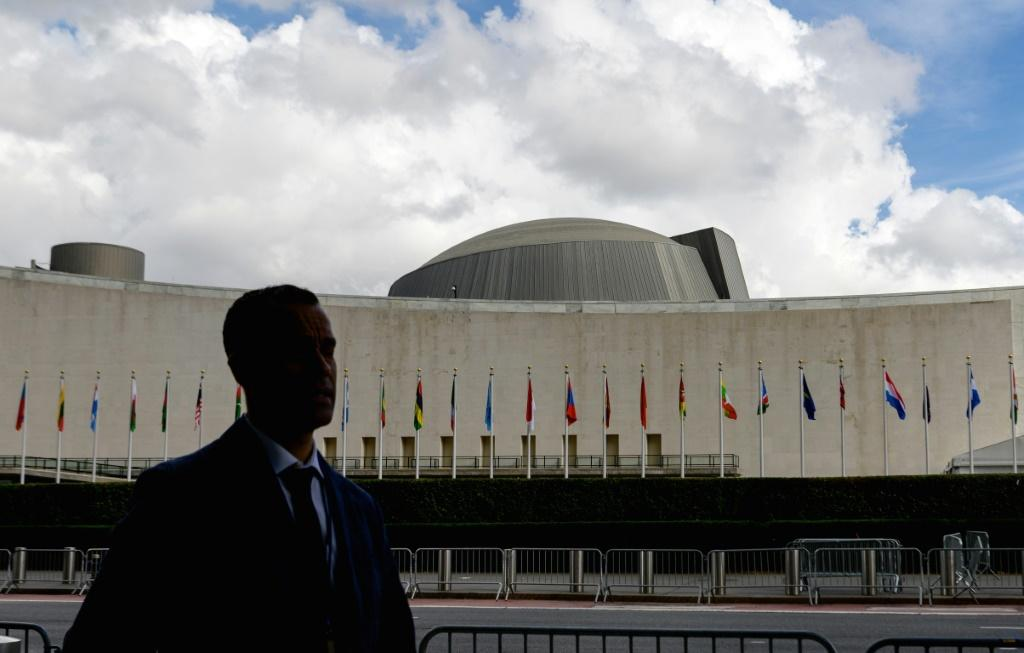 A man walks past the United Nations Headquarters during the 76th Session of the UN General Assembly
