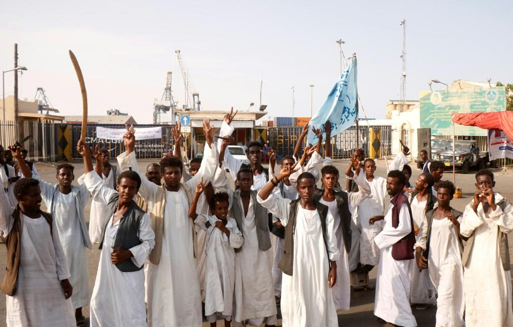 Demonstrators unhappy with parts of a 2020 peace deal with ethnic minority rebels gather outside the docks in Port Sudan on Monday, one of a string of protests against the transitional government's policies in recent months