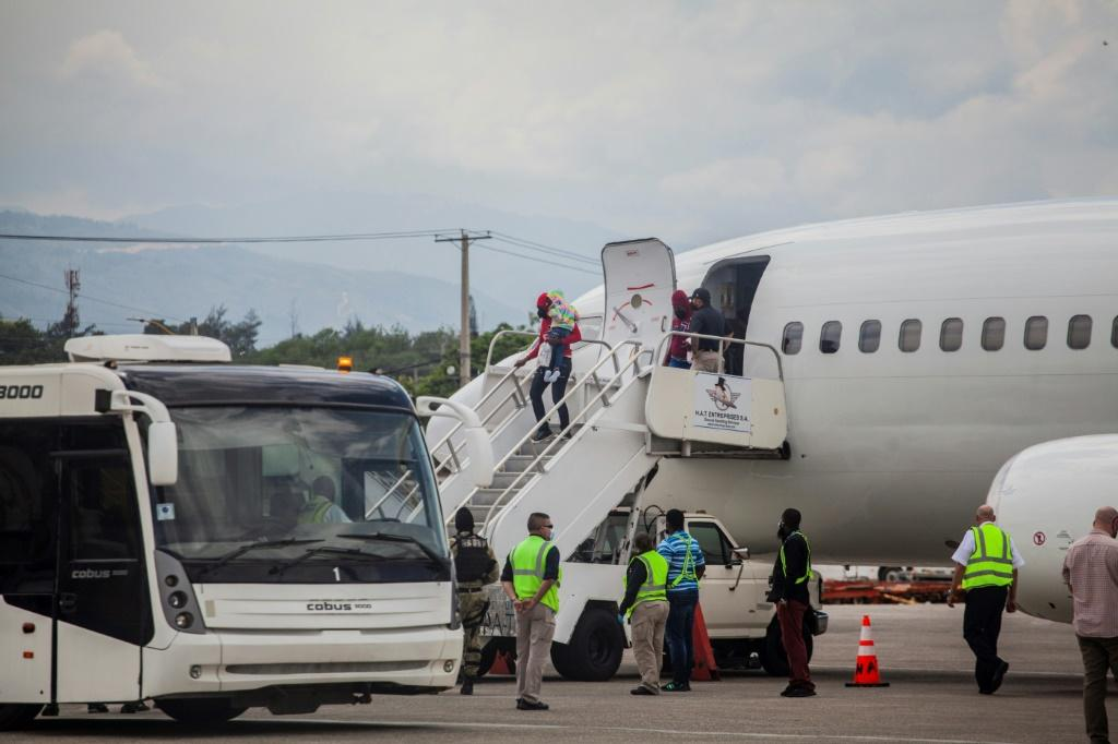 Deported Haitian migrants arrive at the Port-au-Prince airport on September 19, 2021