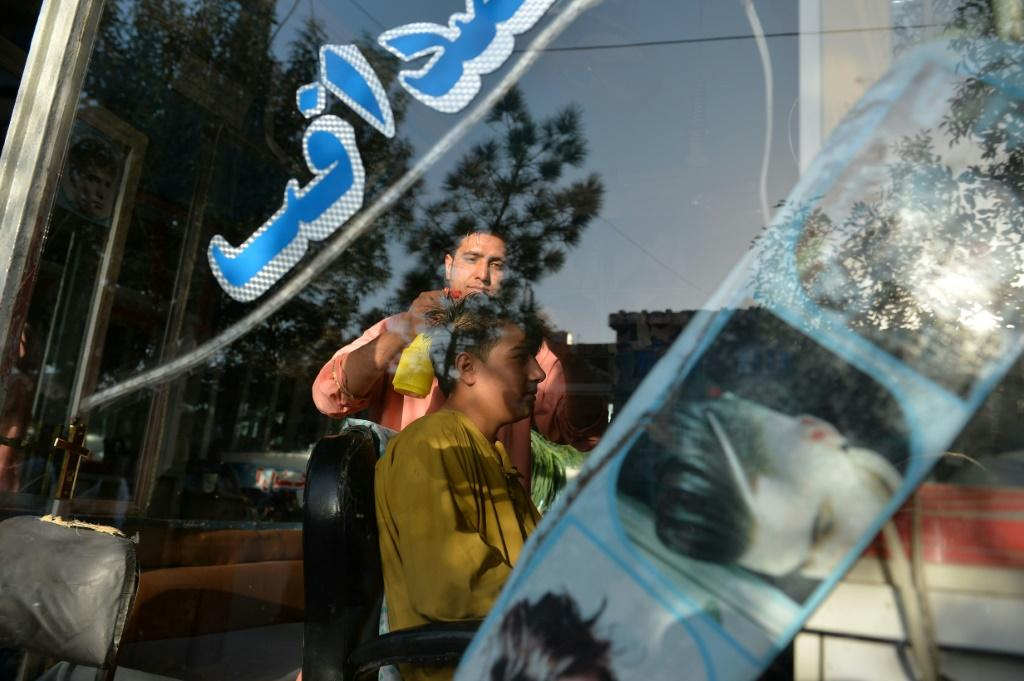 During the Taliban's 1996 -2001 rule, the hardliners banned flamboyant hairstyles and insisted men grow beards