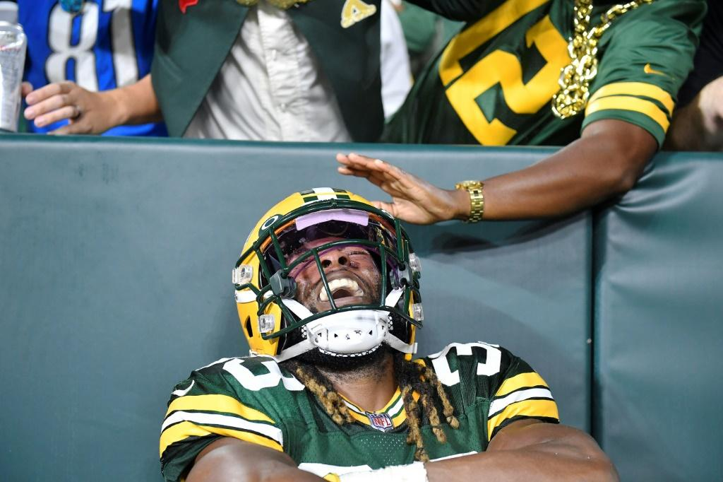 Green Bay Packers Aaron Jones shone in the first regular-season game with a packed house at Lambeau Field since the death of his father from Covid-19