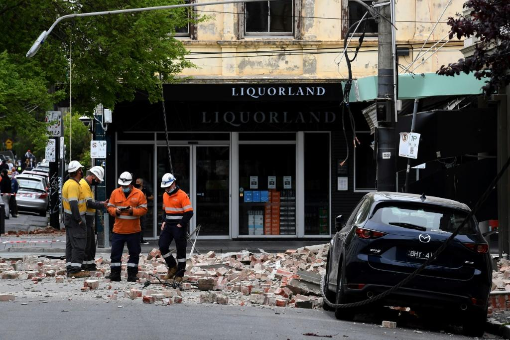 In the popular shopping area around the city's Chapel Street, masonry debris tumbled from buildings and littered the roads