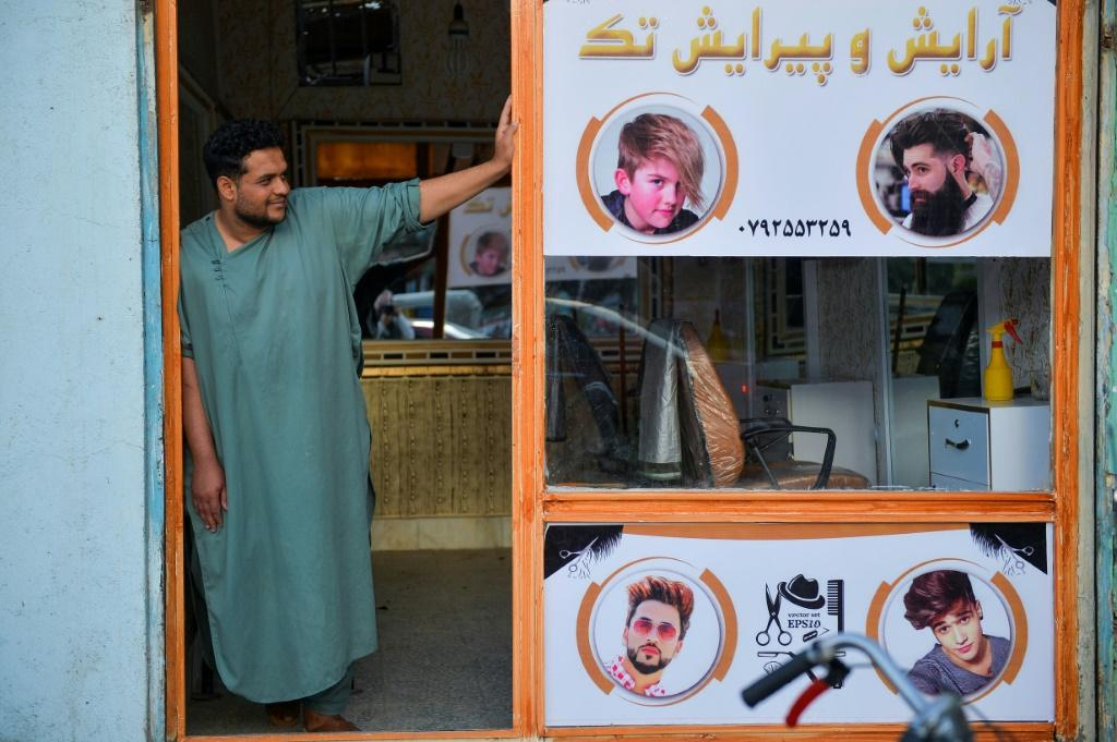 Since the Taliban swept to power in mid-August, Afghans have little cash to spare for visiting barbers and fear being punished for sporting short or fashionable cuts